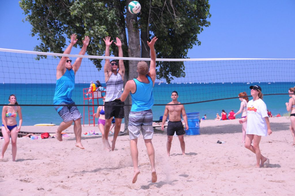 Bunch of youth playing beach volleyball