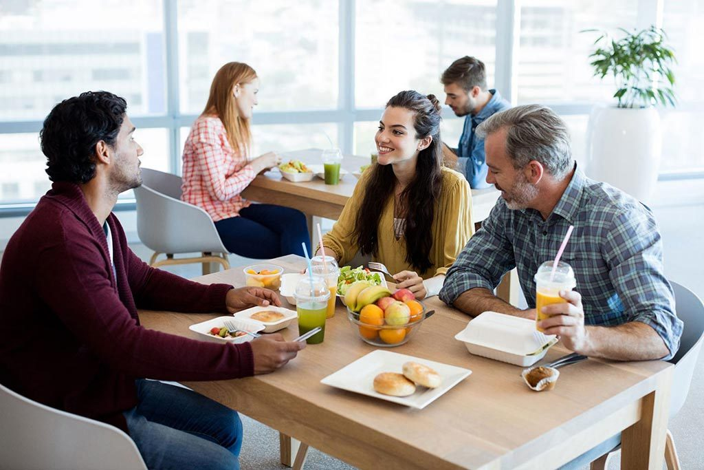 Three people enjoy lunch at restaurants nearby