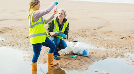 Two inspectors examine beach water sample.