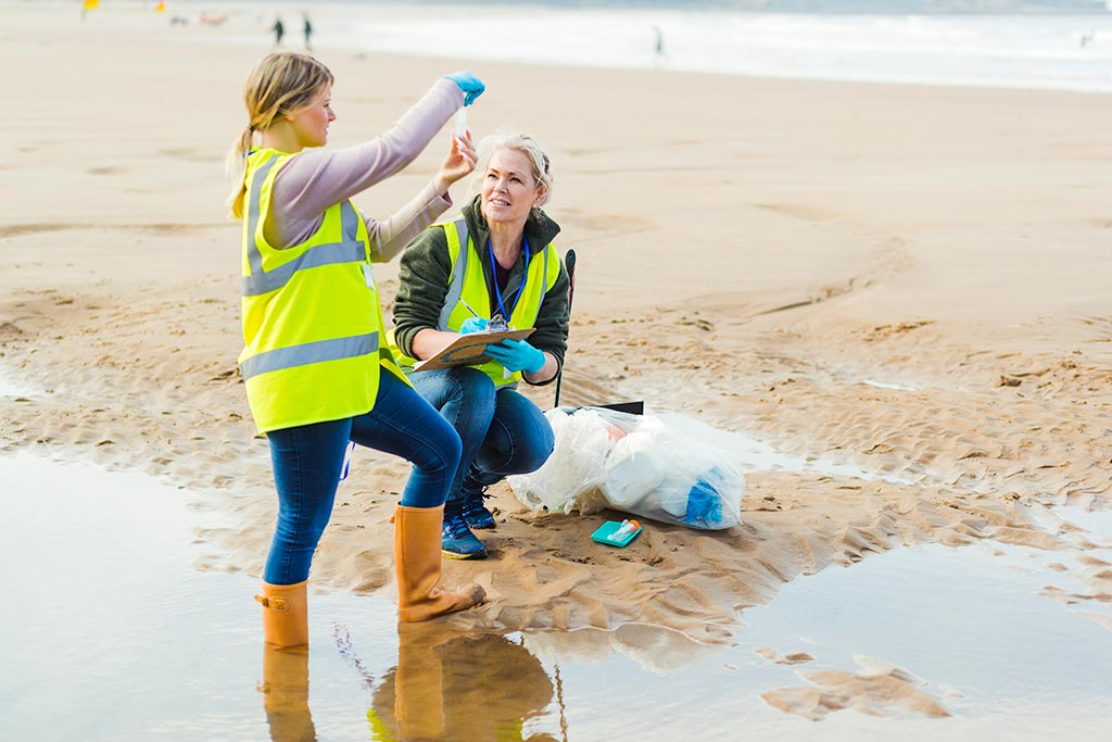 Two inspectors examine beach water sample