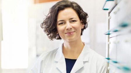 A health-care provider in a white coat.