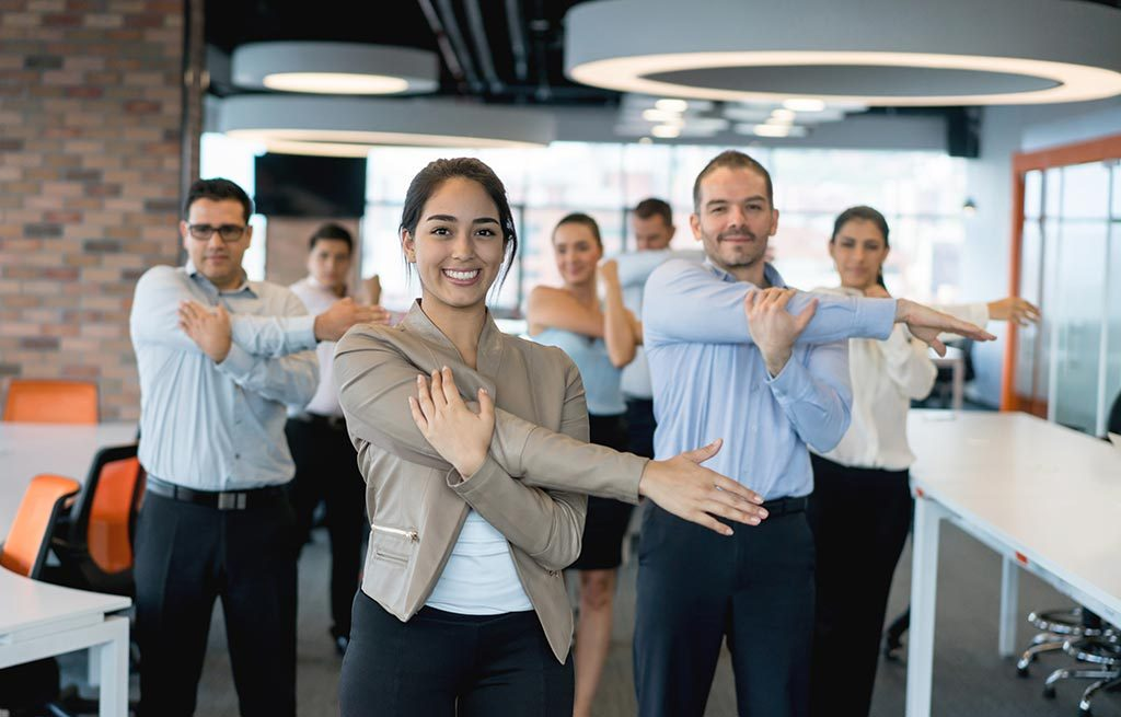 Group of office workers doing stretches