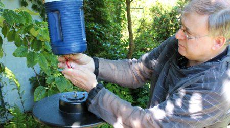 Lambton Public Health inspector setting up a mosquito trap.