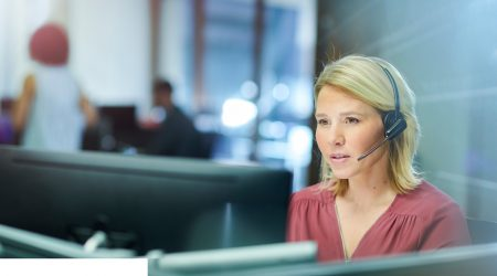 A woman answering a call at a call centre.
