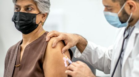 A woman receives the COVID-19 vaccination.