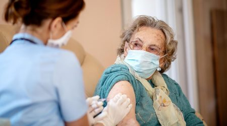 An elderly woman receiving the COVID-19 vaccine.